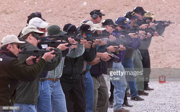 ME1201range8AS Front Sight Nevada With shell casings flying one of two groups fire away on the firing line as students learn the proper stance while...