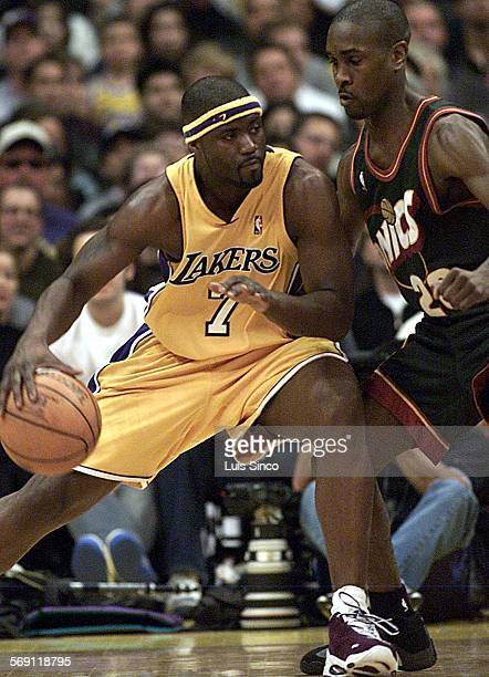 SP1208lakers4LS Lakers guard Isaiah Rider dribbles against Seattle's Gary Payton in the second half of Friday's game at Staples