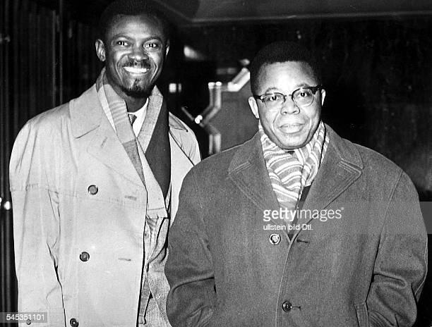 *Politiker BelgischKongoLumumba mit Joseph Kasawubuauf dem Weg zu den Verhandlungen mitder belgischen Regierung über dieUnabhängigkeit von...