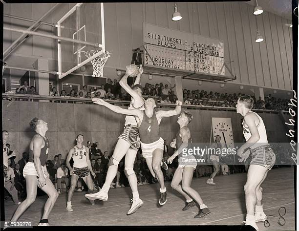 Helsinki Finland America wins basketball today when they beat the USSR team photo shows incident around the American basket Robert Albert KurlandUS...