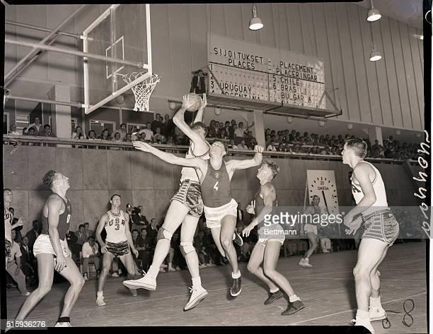 Helsinki Finland America wins basketball today when they beat the USSR team photo shows incident around the American basket Robert Albert KurlandUS...