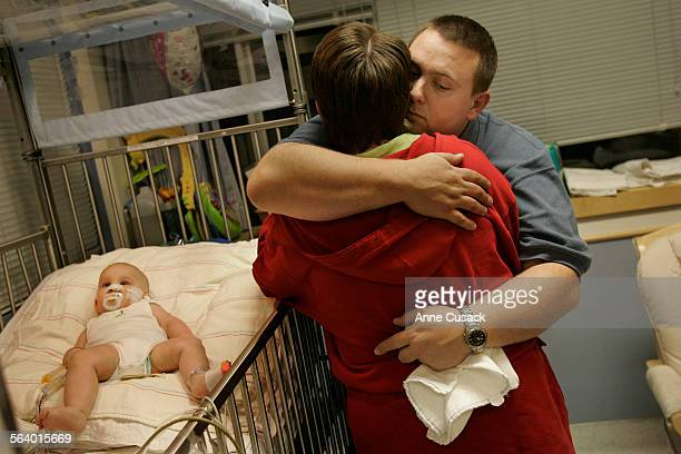 Westwood Before Nicholas Draper heads off to surgery Nicole Draper and Mike hug by his bedside 7 month old Nicholas Draper received a donor heart in...