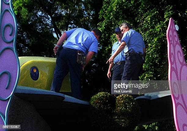 Disney.RL––Anaheim––Inspectors check out a cart at the Alice in Wonderland ride at Disneyland on Thursday afternoon where earlier in the day a...