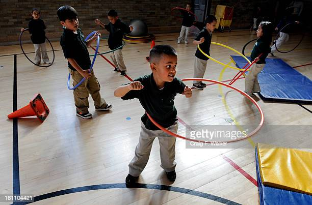 021909_pcoPE_CFW Cesar Figuroa uses a Hulahoop during a physical education class lead by John Bellis at Cole Arts Science Academy in Denver CO The...