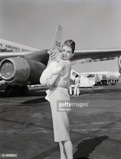 Los Angeles, CA: Actress Audrey Hepburn and son Sean, 7 months, leave for Rome via jetliner 2/21. She eventually will join husband Mel Ferrer in...