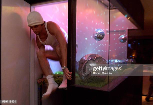 SO0223humanart1RG –– Marc Fearney climbs out of the display case located in the lobby of the Standard Hotel in Hollywood after posing for pictures...
