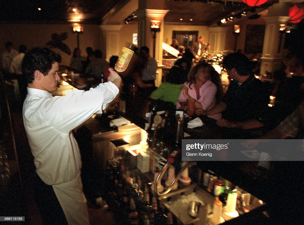 027295.CA.0330.brennan.2.GK Jeremy Welsh tends bar in the Flambeau ...