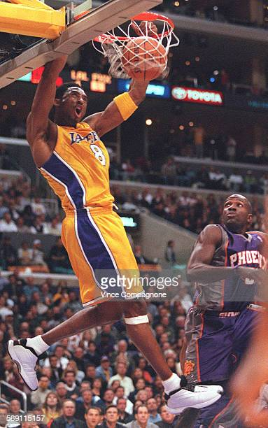 Lakers1VC The Lakers Kobe Bryant is back and in form as he gets two points on a ally–oop fast break against Phoenix as the Suns Tony Delk can only...