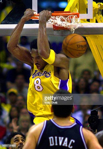 cheap for discount b0d38 cc19b SP0506lakers4WS Lakers Kobe Bryant slam dunks two of his twenty–nine points  against in the