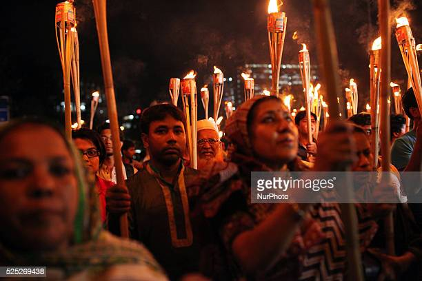 Cultural activists writers and members of the Ganajagaran Mancha shout slogans as they attend a torch light procession protesting the killing and...