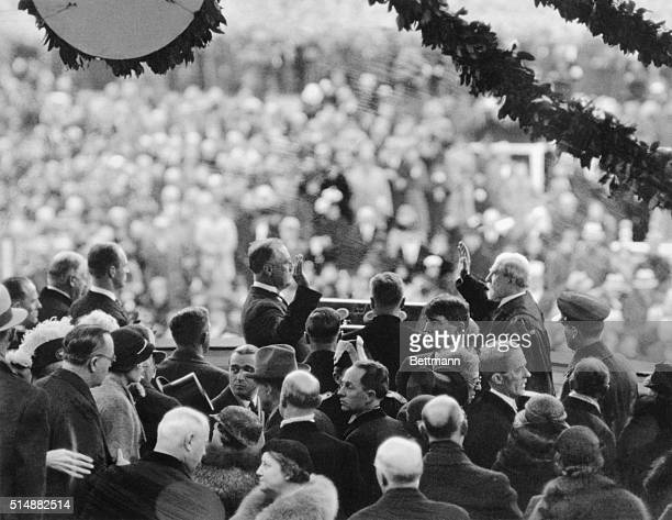 03/04/33Washington DC This unusual glimpse of the inaugural ceremonies was taken from behind the inaugural stand as President Roosevelt took the oath...