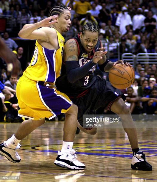 Lakers15.WS 76'ers Allen Iverson drives past Lakers Tyron Lue in the fourth quater in Game 1 of the NBA Chamionship at the Staples Arena Wednesday.
