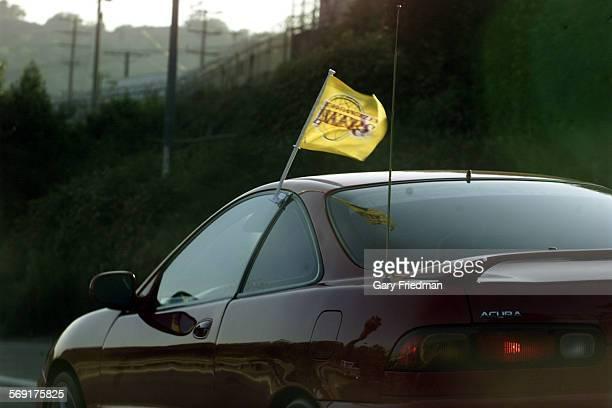 So.0529.flags1.gf A car along the southbound 110 Pasadena freeway sports a LA Laker flag.