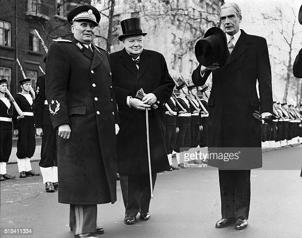London England Marshal Josip Broz Tito President of Yugoslavia receives a warm welcome from Prime Minister Winston Churchill and Foreign Secretary...