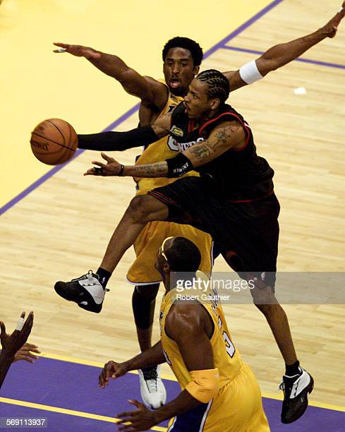 Finals1.RG –– Allen Iverson drives past Kobe Bryant and passes the ball to a teammate in the first quarter during game one of the NBA Finals at the...