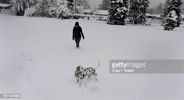 032410_weather_CFW Anna Rogalska and her dog Ella weren't going to let the spring storm keep them from their daily visit to Jason Park in Englewood CO