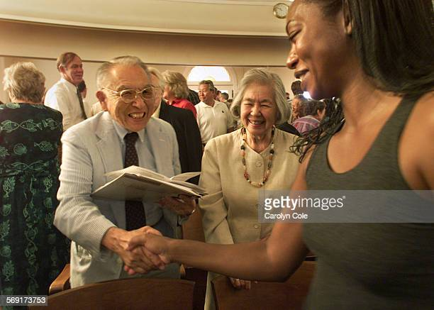 ME0812churches2ccDr James Yamazaki his wife Aki Yamazaki center greet Alisa Melendrez member of Mt Hollywood Congregational Church
