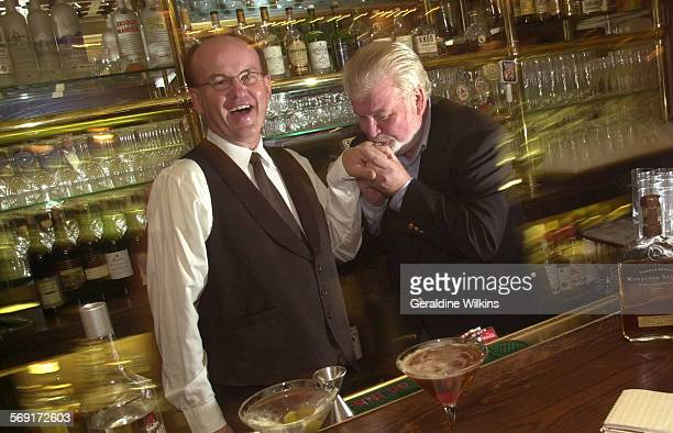 Bar.GW–– left to right–– Lee Williams of Moreno Valley has his Bartender Hall of Fame ring kissed by Raymond P. Foley, publisher of Bartender...