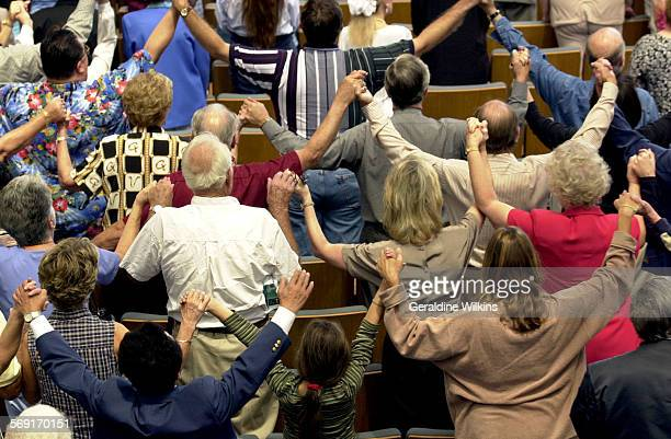 Me.0911.terrorist11.GW––Garden Grove–– Church members at Crystal Cathedral join hands in a prayer service for the victims of the terrorist attack at...
