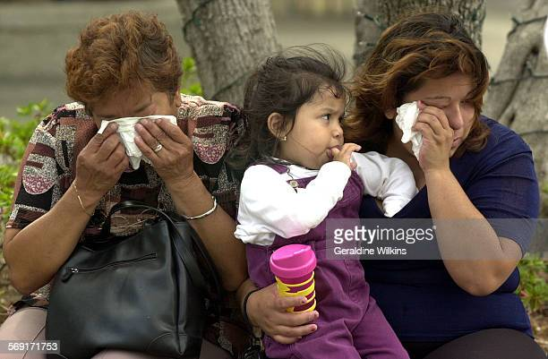 Me.0911.terrorist4.GW–– left to right–– Anaheim residents, Angelica Sanchez her granddaughter Marianna Sapon and daughter Roxana Sapon, 26 are...