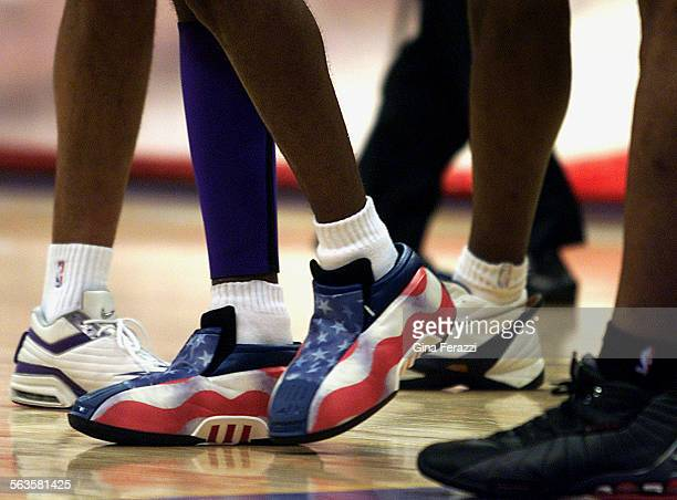 SP1030lakers9GF– PATRIOTIC FEAT Laker Kobe Bryant shows off his specially made patriotic shoes during opening night against Portland Tuesday at...