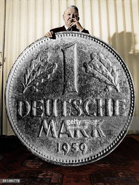 *04021897German politician with a giant Deutsche Mark coin