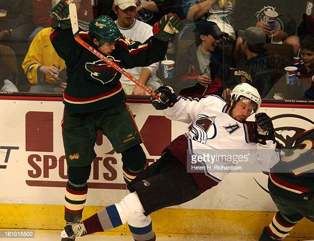 041003Colorado Avalanche's Peter Forsberg left gets upended by Minnesota Wilds' Willie Mitchell #2 during the third period of the first round of the...