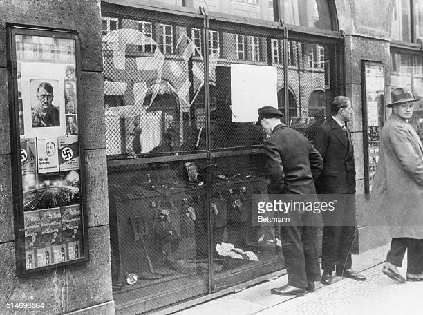 Berlin,Germany. NAZI HEADQUARTERS. HITLER STRONGHOLD IN BERLIN. Former members of the Nazis, of socialist party of Adolf Hitler, gazing ruefully into...