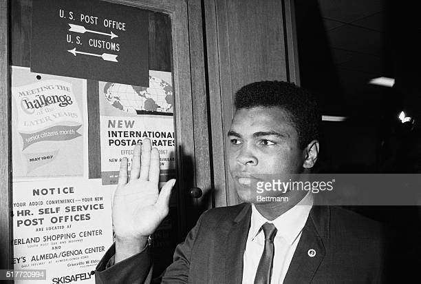 Houston: Heavyweight champion Cassius Clay waves at fans as he arrives at Army Induction Center where he is scheduled to be inducted into the Army....
