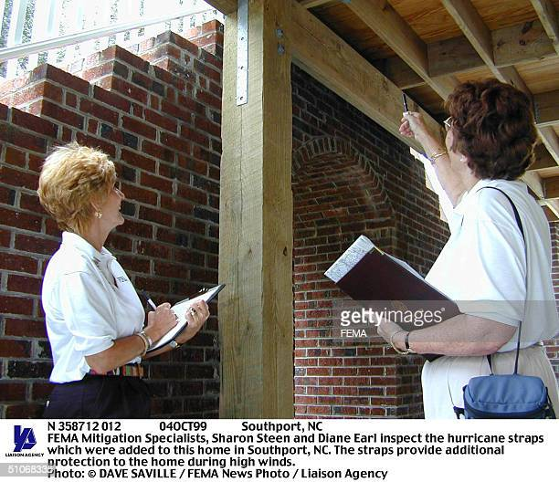 04Oct99 Southport, Nc Fema Mitigation Specialists, Sharon Steen And Diane Earl Inspect The Hurricane Straps Which Were Added To This Home In...