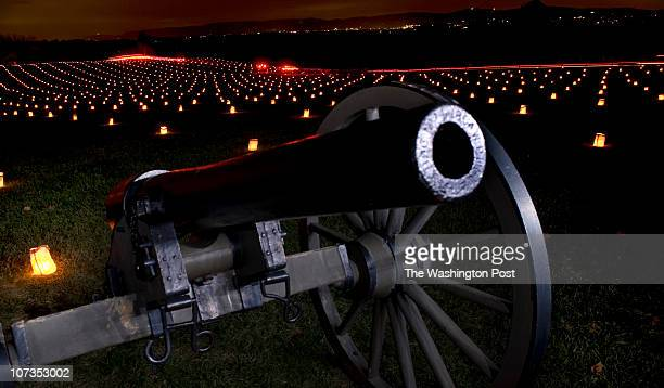 Streaks of lights from vehicles that drove through the Antietam National Battlefield to view the 22nd annual memorial Illumination on December 04 in...