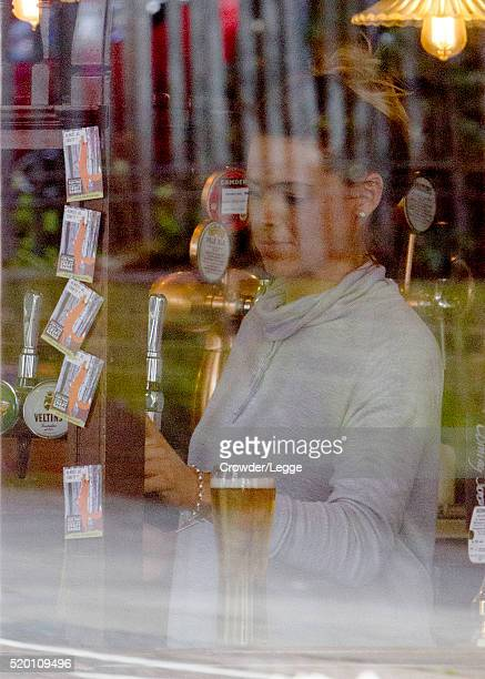 Former British soap actress Shana Swash is seen working in a pub April 04 2016 in London England