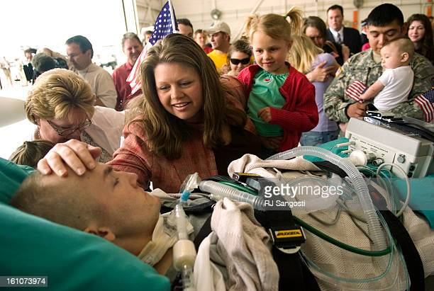 HOMECOMING24ENGLEWOOD 05/24/07Christine Townsley holding her daughter Samantha reaches out to touch her brotherinlaw Staff Sgt Matthew Keil who was...