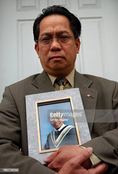 Willie Reodica holds a grade 8 graduation picture of his son Jeffrey who was shot by an undercover police officer last Friday