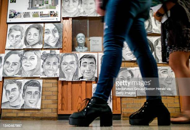 Boston,MA. Students peer at some of the 410 Charcoal drawings of the graduating seniors of Boston Latin's Class of 2016, as they hang in the halls of...