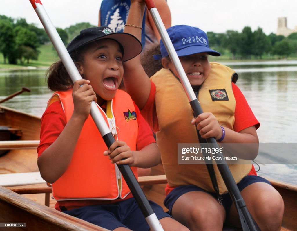 052798Elementary school kids K-3 will practice water safety (in three canoes). Wilderness Inquiry will teach the kids how to have fun and be safe around water.  ---   -- Jenae Hardwick (cq) and Lauren Tillman, the first ones in the canoe, react to the tip : News Photo