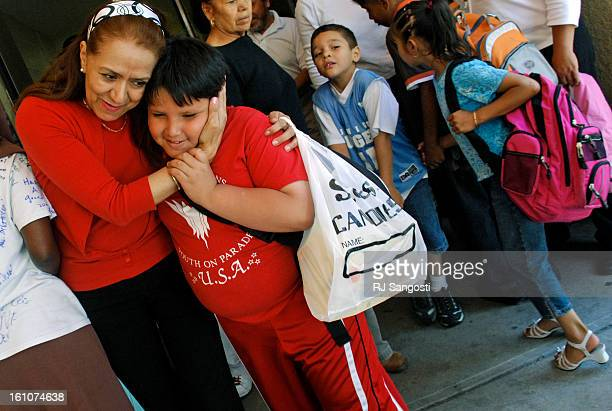 SCHOOL30DENVER 05/30/07First and second grade teacher Charlotte De LaTorre hugs 9yearold Raul Ortiz one of her former students as students rush out...