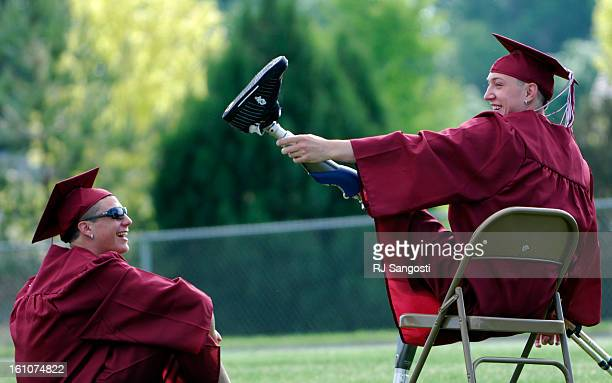 BERTHOUD02 BERTHOUD 06/02/07Tyler Carron right plays around as he waits with his friend Spenser Sadlo for their high school gradation Carron who lost...