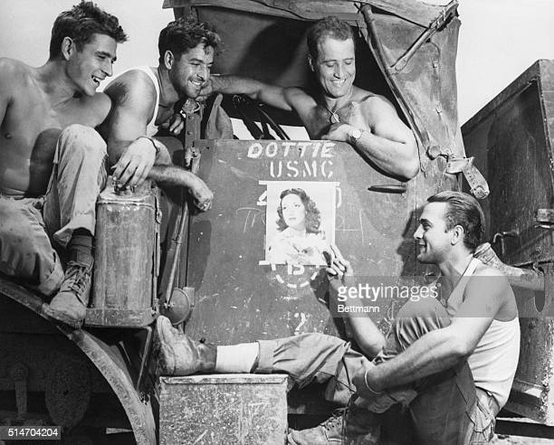 Glamorous Dorothy Lamour is the pinup girl of leatherneck motor transport battalion on Okinawa Pointing to the film star's photo is PFC Edward M...
