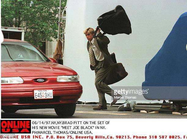 Brad Pitt in a scence from his new movie'Meet Joe Black' in which he is strucked by a minivan and thrown onto a speeding taxicab