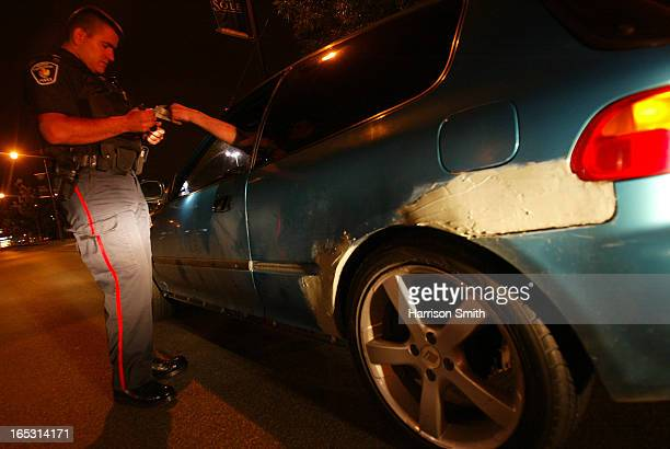 ErasePhoto111167York Police officer Mike Lacroix checking vehicles for illegal modifications for street racing purposes On Friday night York police...