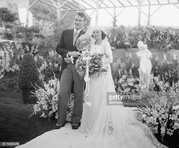 Los Angeles CA John Wayne motion picture actor and his bride the former Miss Josephine Saenz daughter of Dr Jose Saenz Panamanian Counsul in Los...