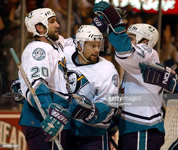 SP0428ducksRDL–– Anaheim Mighty Ducks Steve Rucchin left is congratulated by teammates Petr Sykora center and Adam Oates after his goal in the first...