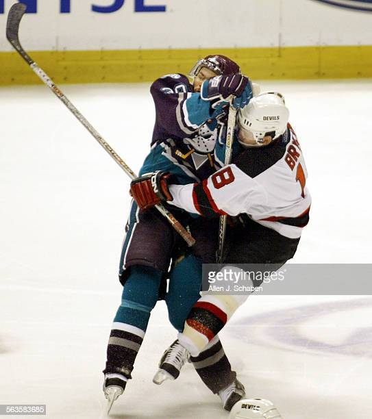 SP0527ducksAJS––Anaheim's Petr Sykora collides with New Jersey's Sergei Brylin late in the third period of game one of the Stanley Cup Finals Tuesday...