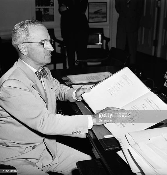 Washington,D.C.: President Harry Truman examines the lengthy World Security Charter drawn up at the recent San Francisco conference, and points to...