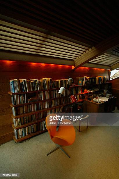 LautnerAS152Bookcases contemporary chairs and louvered light in upstairs study at house built 23 years ago by John Lautner along boardwalk on Balboa...