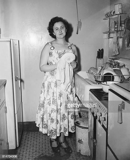 ACCUSE HUSBAND AS SPY Mrs Ethel Rosenberg dries dishes in her knickerbocker village home July 18 as she talks to reporters after her husband Julius...