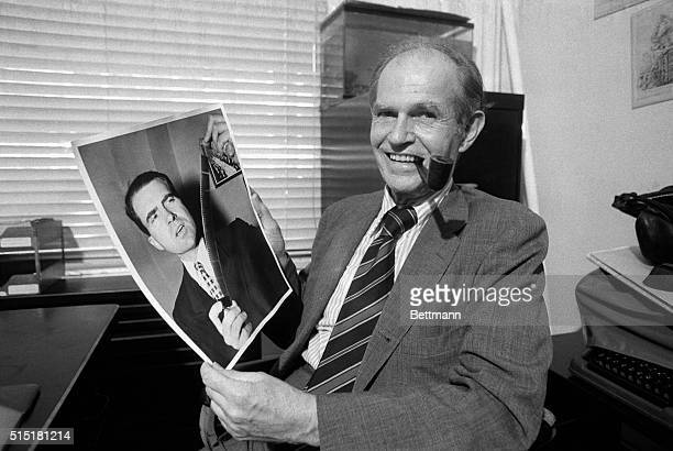 07/31/75New York NY Alger Hiss smiles as he looks at a picture of thenRep Richard M Nixon holding up one of the Pumpkin Papers film strips Nixon had...