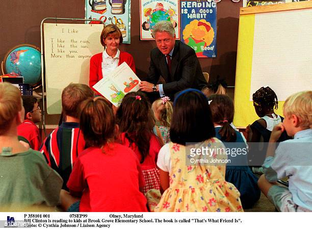 P 358101 001 07Sep99 Olney Maryland Bill Clinton Is Reading To Kids At Brook Grove Elementary School The Book Is Called That's What Friend Is