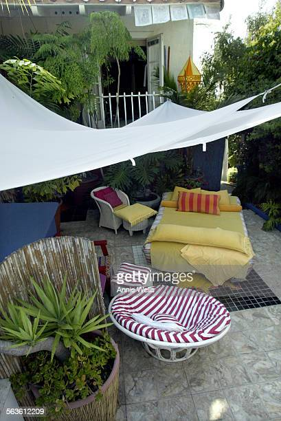 HM0526artists Two artists Myrella Moses and Eric Mondriaan have put together a home filled with fabric This is the entry patio to their home with a...